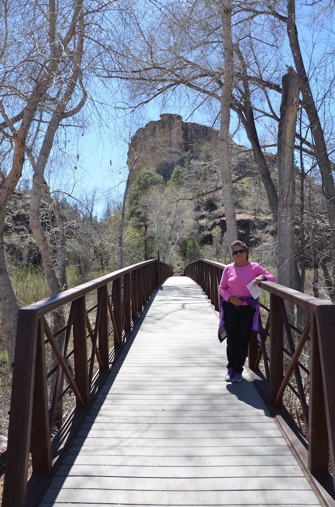 Jan on the first of many bridges along the trail leading to the Cliff Dwellings