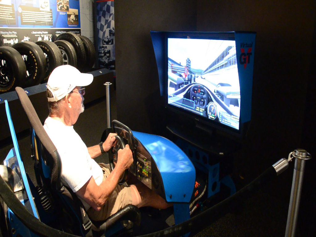 They had a driving simulator too! You start out dead last in 10th and have to work your way through the pack in 5 laps.