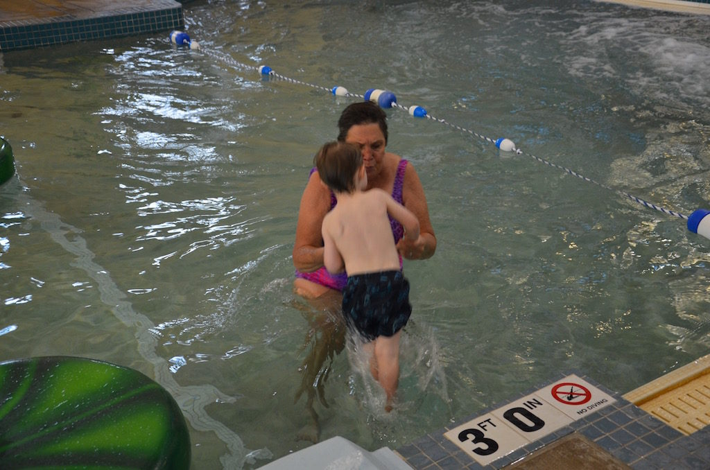 Jan teaching Reeve water safety; how to swim to the side to get out after jumping in. He had a blast!