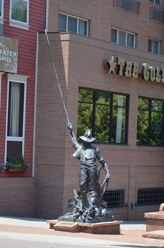 A fly fisherman , one of the many sculptures around downtown.