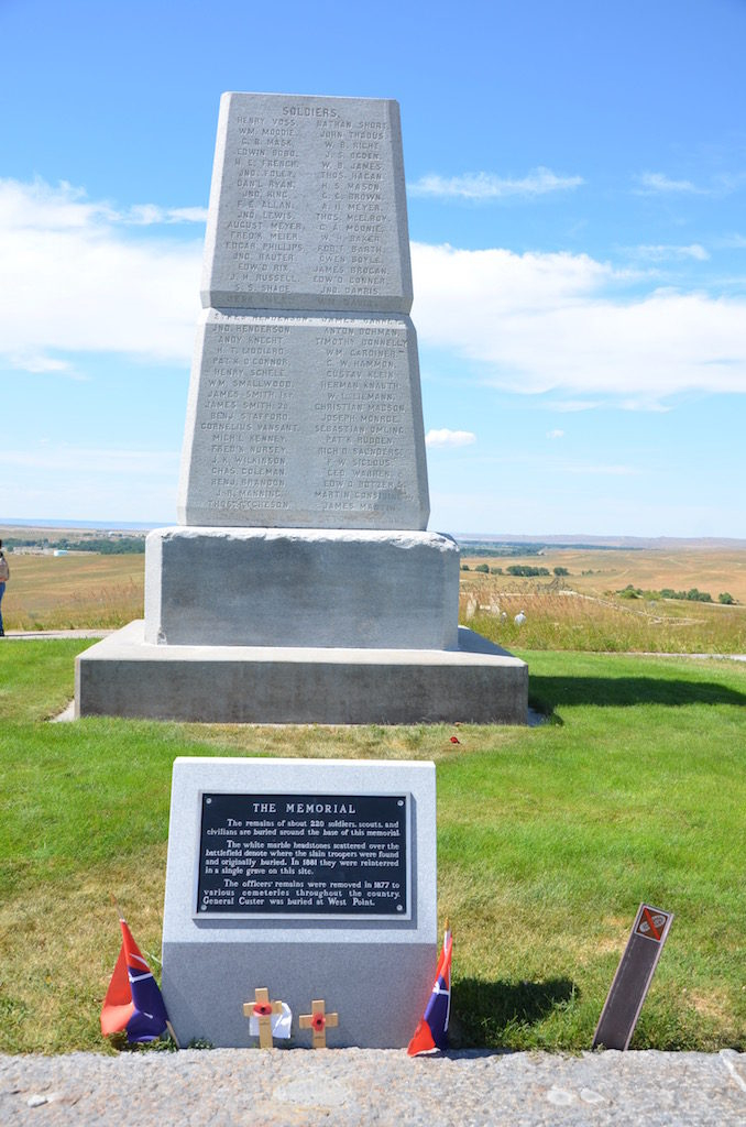 This enclosed cemetery was the men in Custer's command. The black stone is Custer.