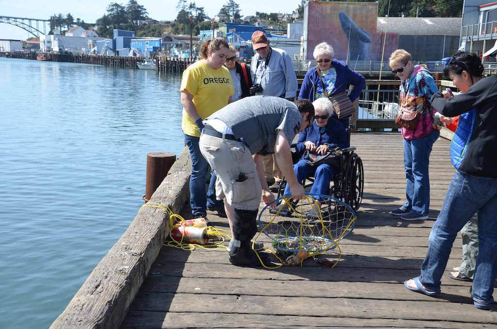 Fishermen on the pier catching crabs.